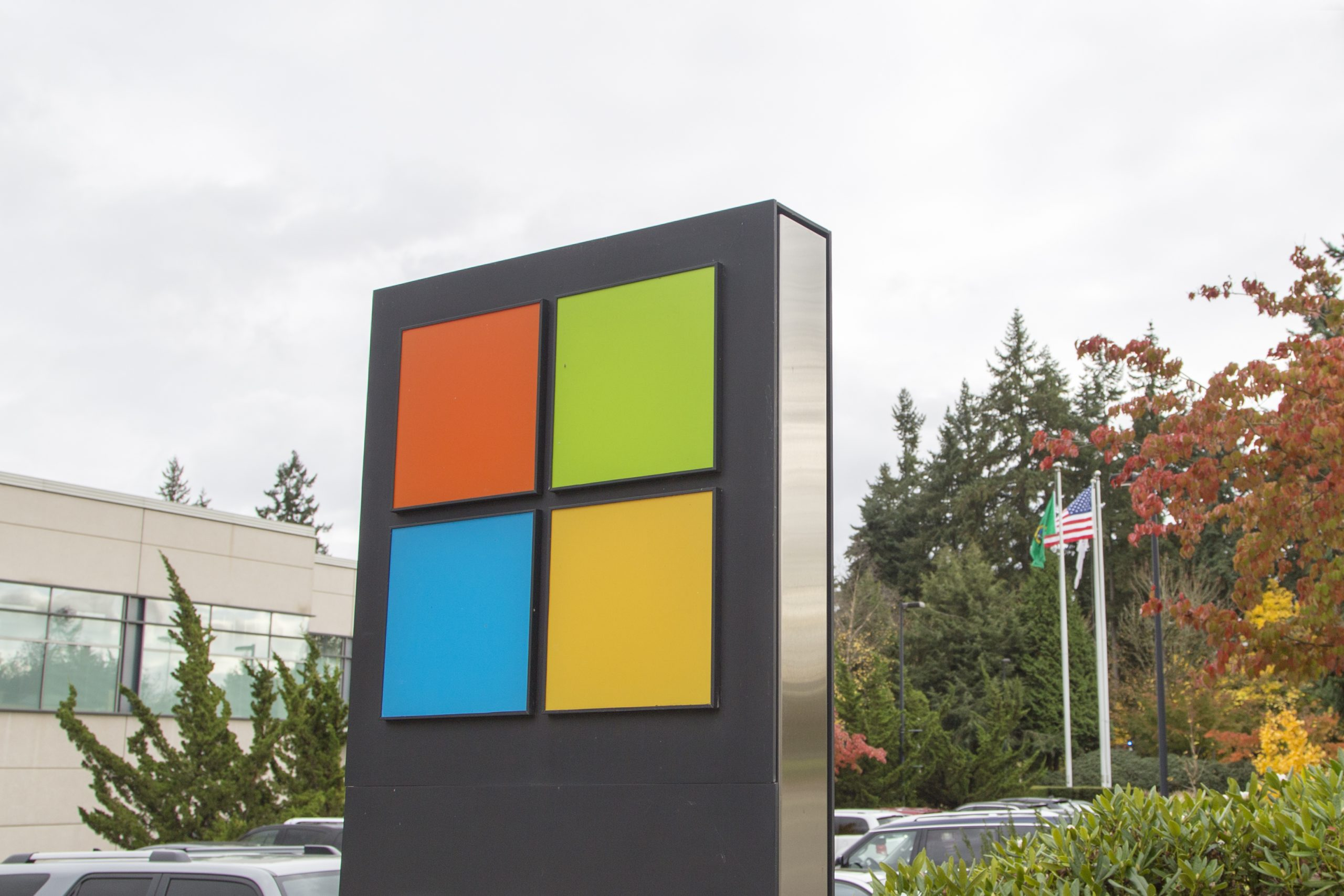 November 1, 2017 - Redmond, Washington: Microsoft's sign and flags of United States, Washington and Microsoft are visible in front of a building at company's corporate headquarters